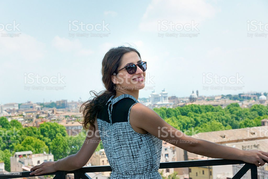 Young woman enyoing  the skyline of Rome stock photo
