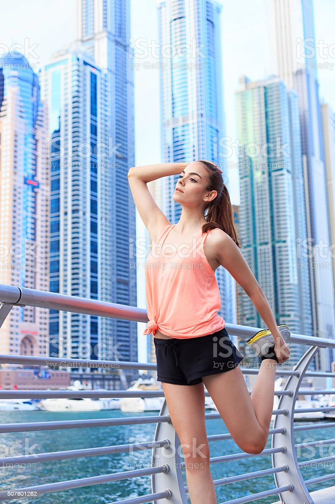 Young woman excerciting in Dubai marina stock photo