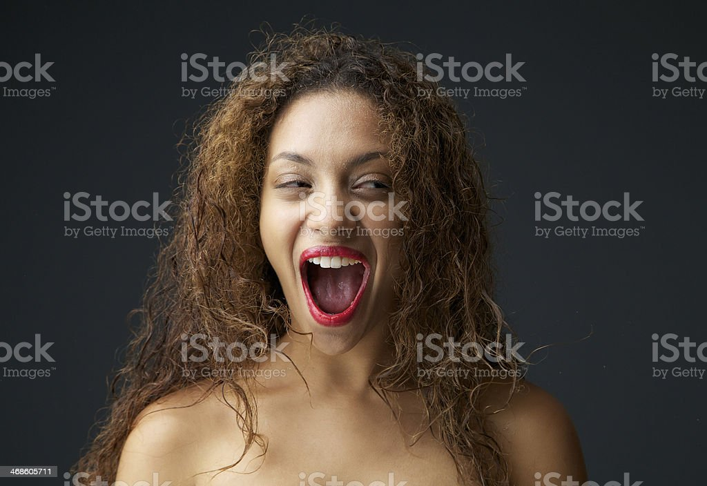 Young woman excited and laughing with open mouth royalty-free stock photo