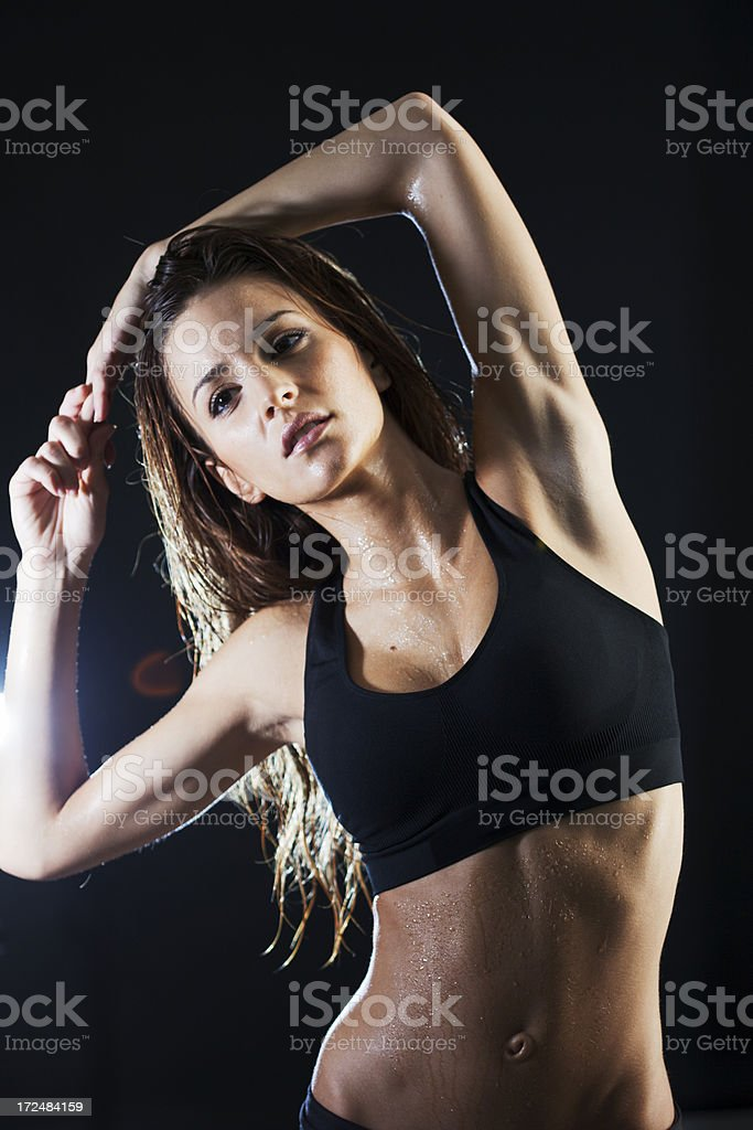 Young woman exercicing in the gym stock photo