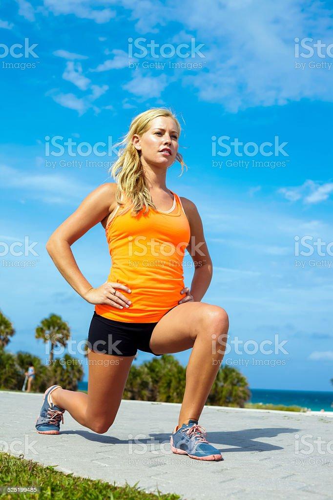 Young Woman Exercising At Beach stock photo