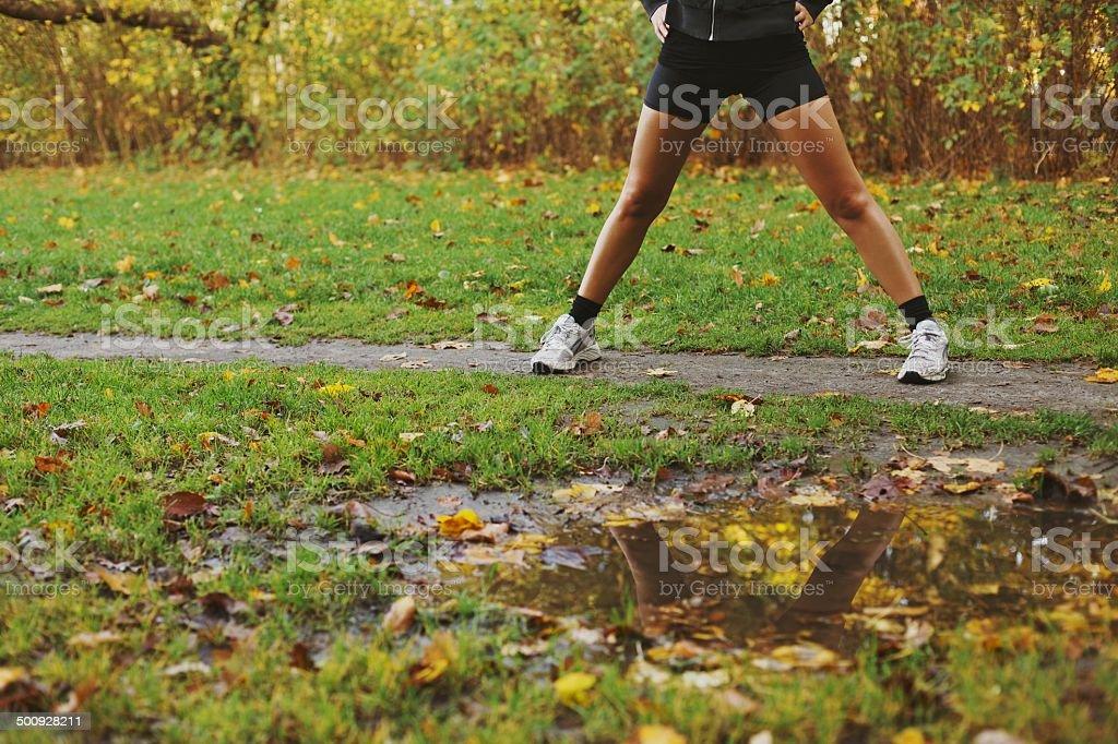 Young woman exercising at park stock photo