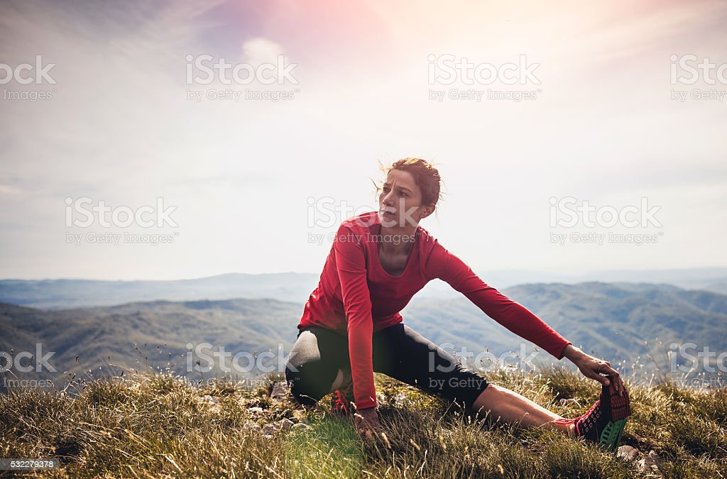 Young woman exercising fitness in nature stock photo