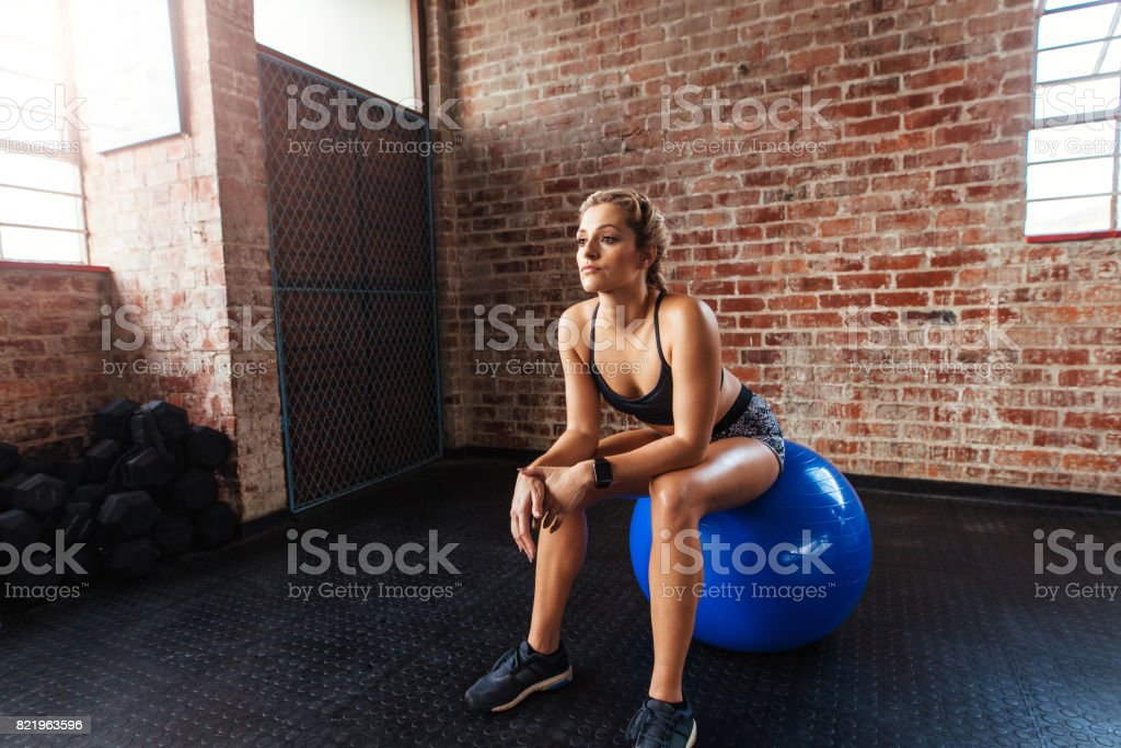 Young woman exercising in gymnasium. stock photo