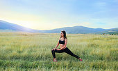 Young woman exercising in nature