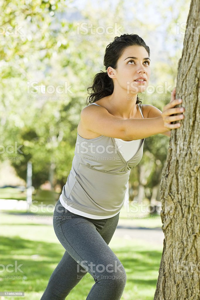 Young woman exercising in park royalty-free stock photo