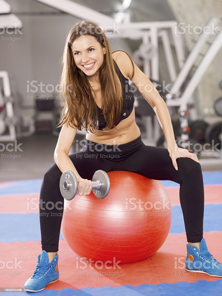 young woman exercising in the gym royalty-free stock photo