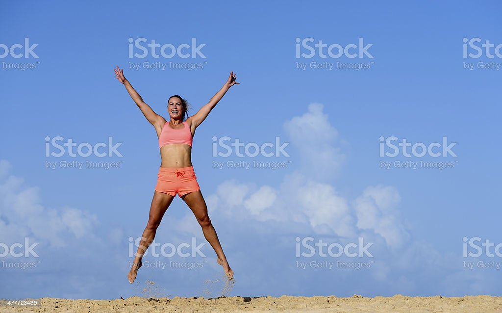 Young Woman Exercising On A Beach stock photo