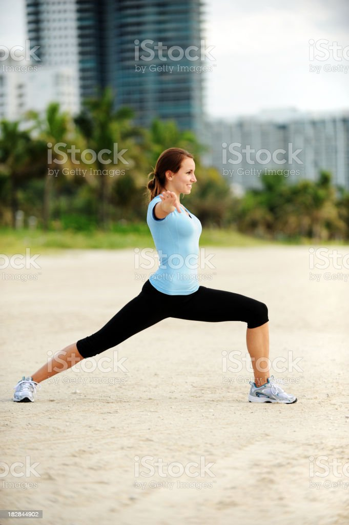 Young Woman Exercising on Beach royalty-free stock photo