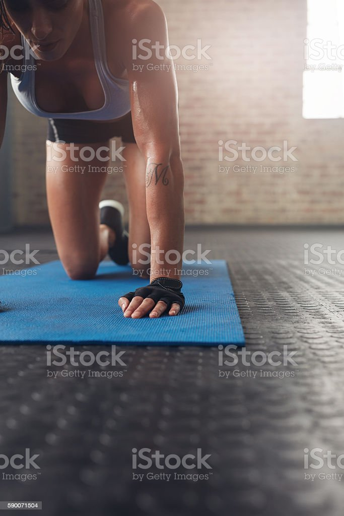 Young woman exercising on fitness mat stock photo