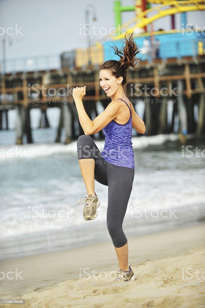 Young Woman Exercising on Santa Monica Beach Aerobics royalty-free stock photo