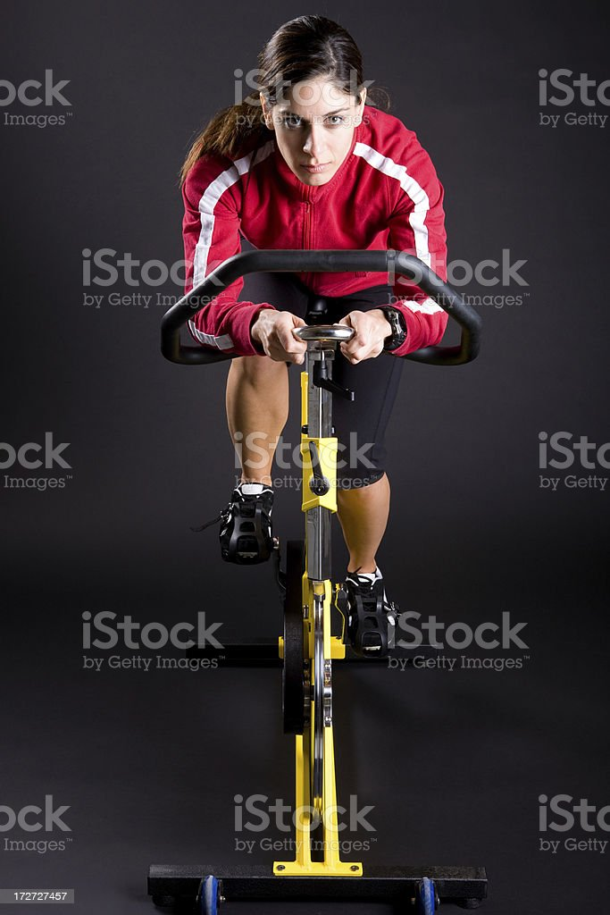 Young Woman Exercising on Spin Cycle stock photo