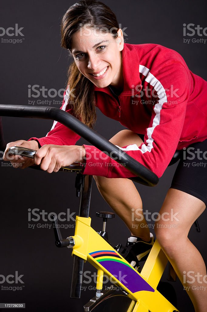 Young Woman Exercising on Spin Cycle royalty-free stock photo