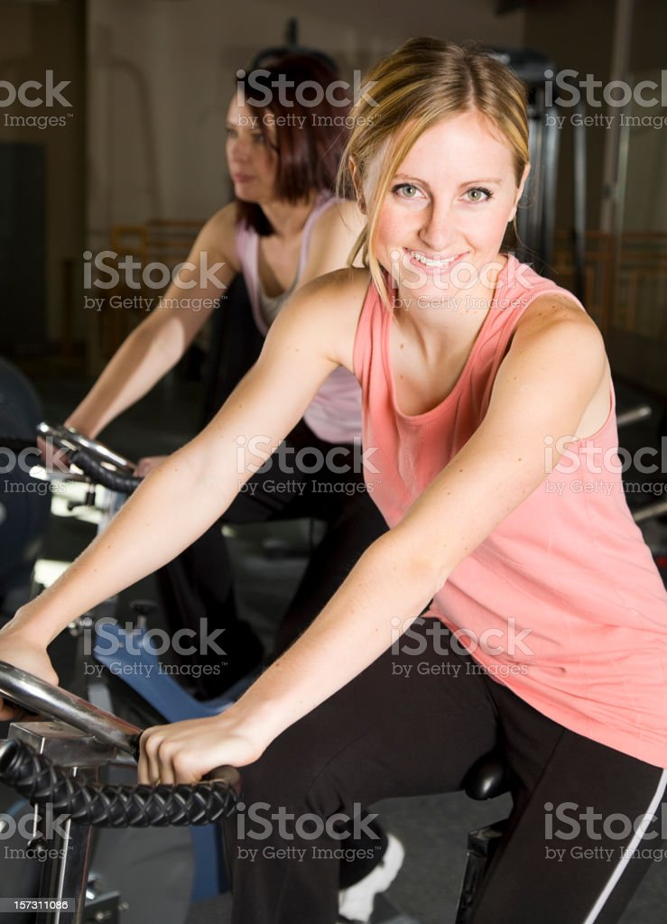 Young Woman Exercising on Stationary Bike royalty-free stock photo