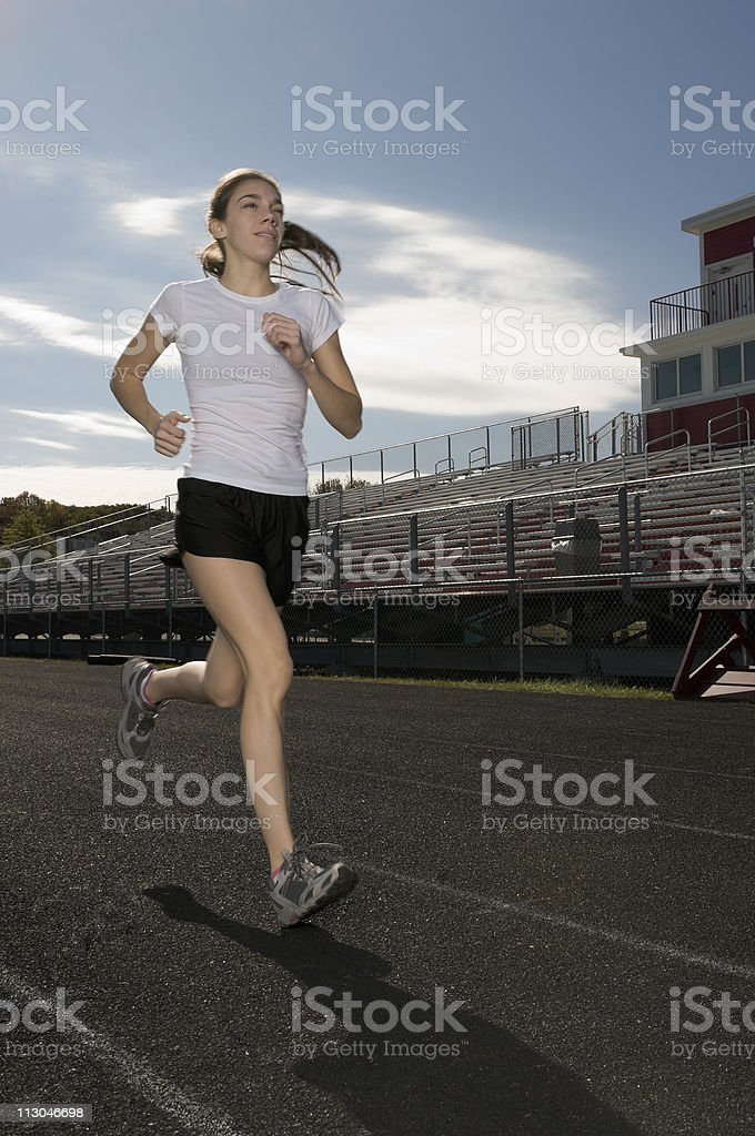 Young woman exercising outdoors royalty-free stock photo