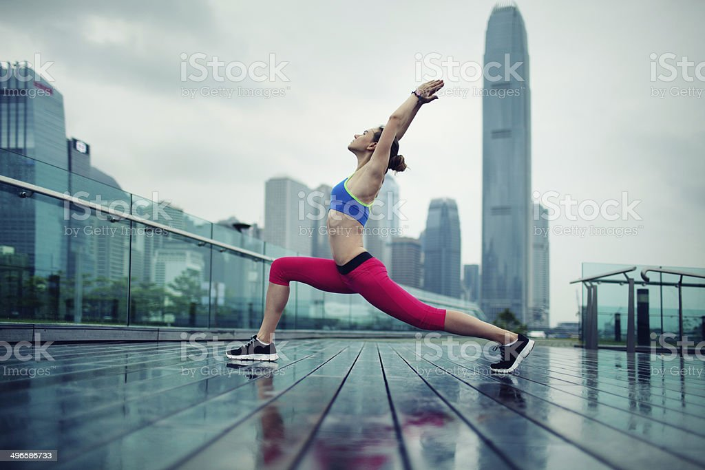 Young Woman Exercising Outdoors stock photo