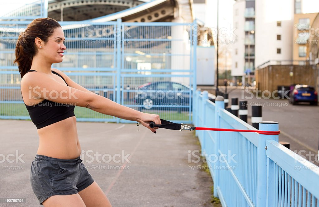 young woman exercising stretching elastic royalty-free stock photo
