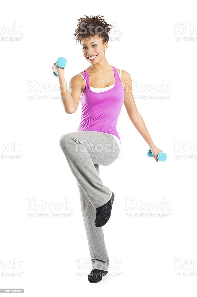 Young Woman Exercising With Dumbbells royalty-free stock photo