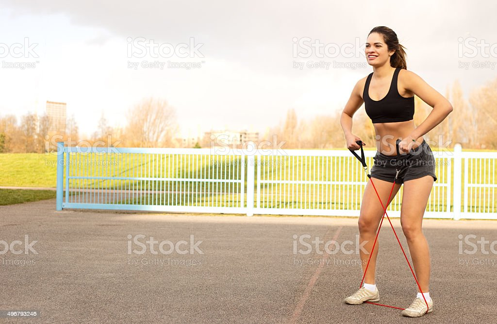 young woman exercising with elastic royalty-free stock photo