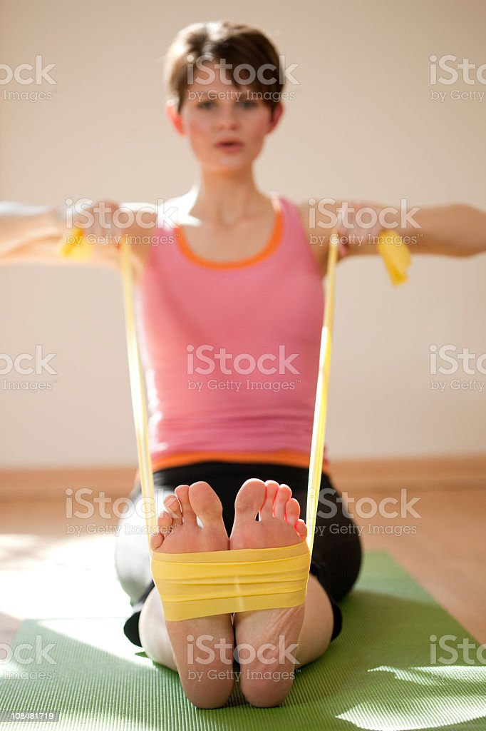 Young Woman Exercising With Resistance Bands stock photo
