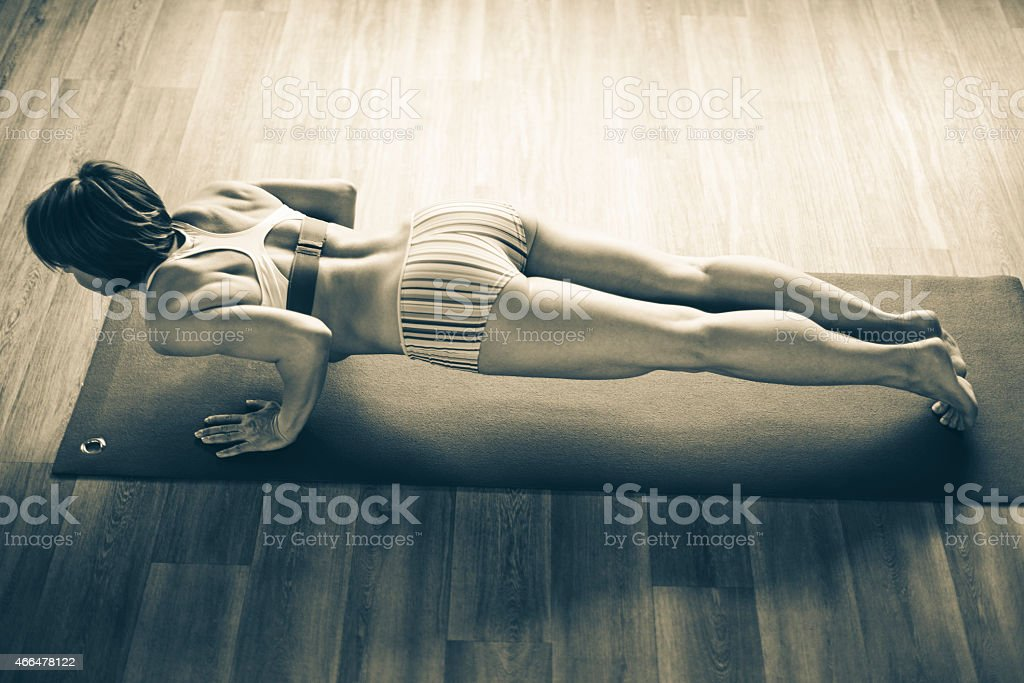 Young woman exercising yoga stock photo