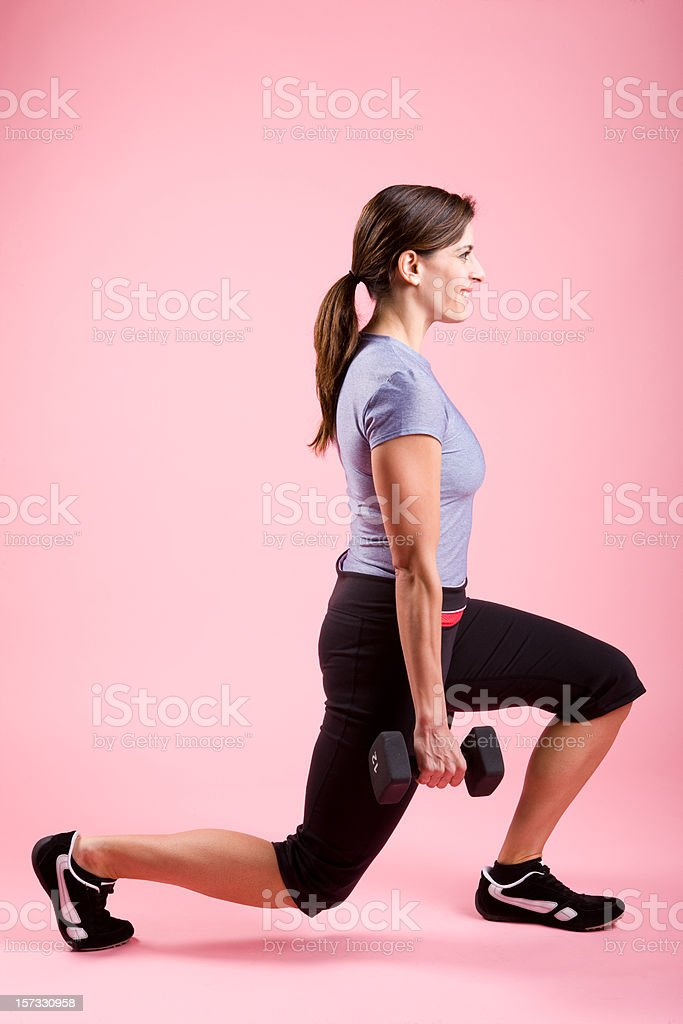 Young Woman Exercising-Lunges with Weights royalty-free stock photo