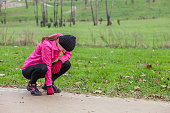 Young woman exhausted after running on a cold winter day
