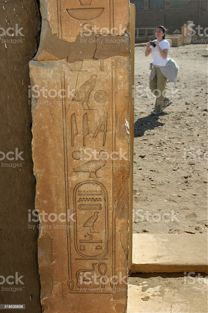 Young woman explores Elephantine Island ruins Aswan Egypt stock photo