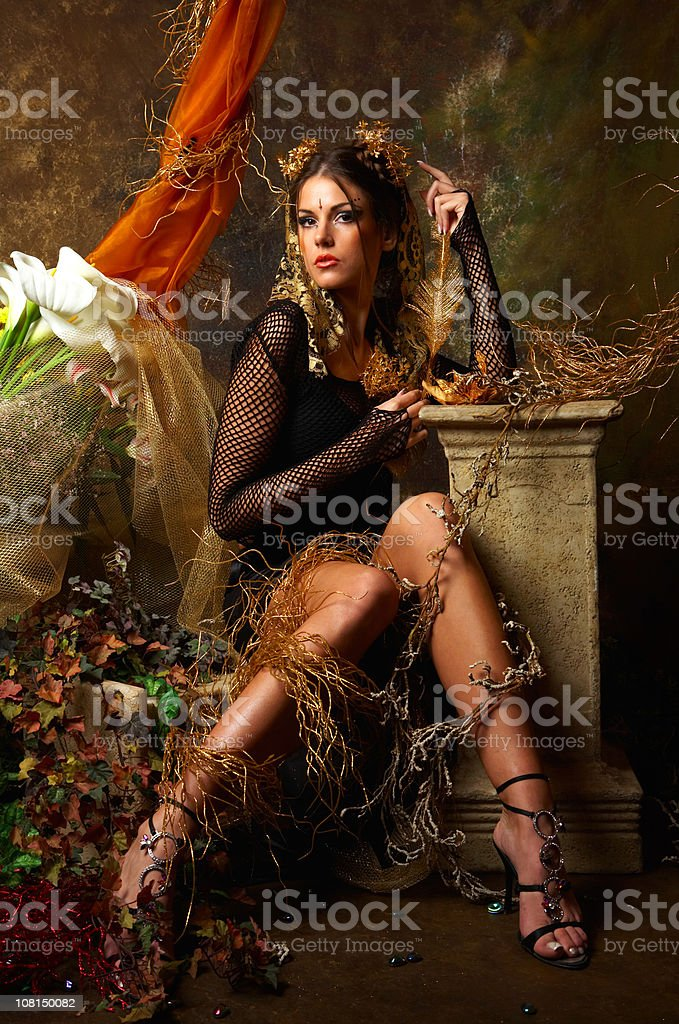 Young Woman Fairy Wearing Black Outfit Posing With Autumn Scene royalty-free stock photo