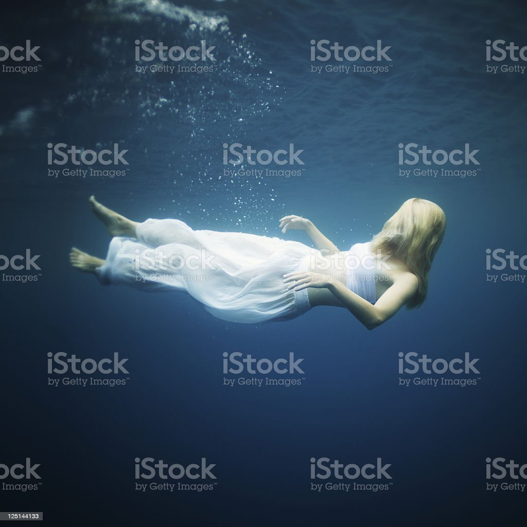 Young woman fall into deep water royalty-free stock photo