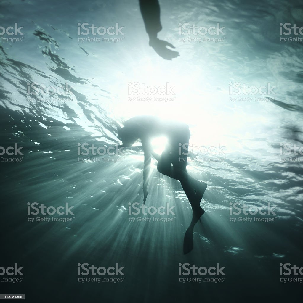 Young woman fall into deep water stock photo