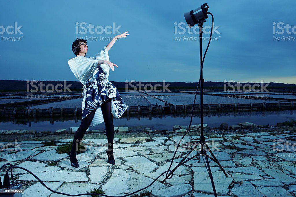 Young Woman Fashion Model Posing In Front of Lights royalty-free stock photo