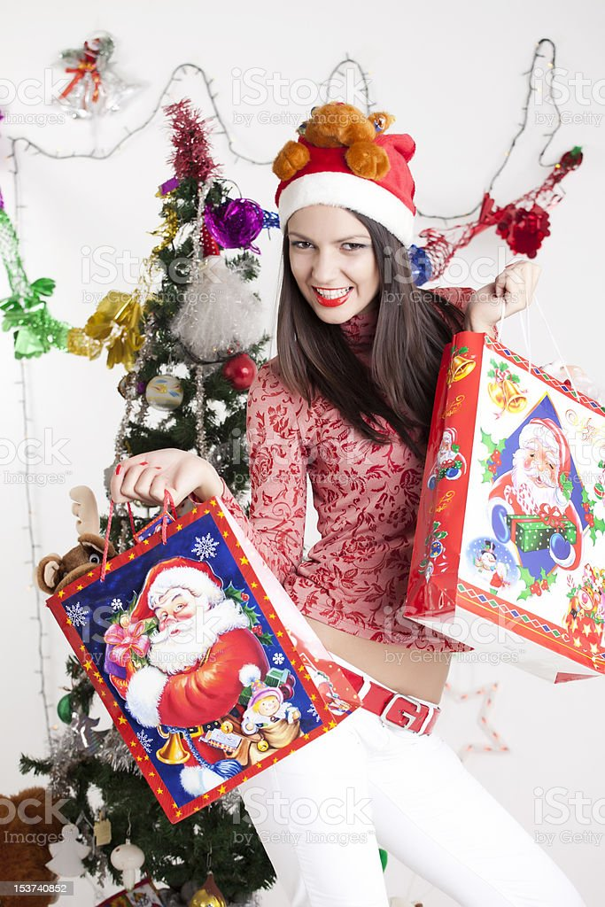 Young woman fashion model with Santa Claus clothing royalty-free stock photo