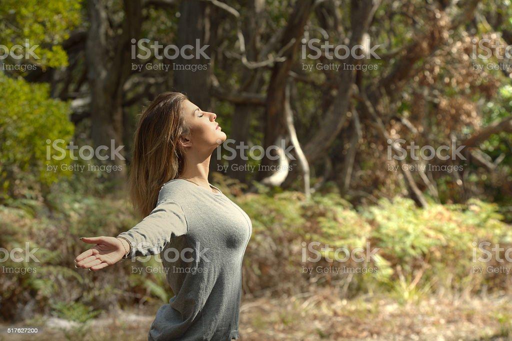 Young Woman Feeling Free - Australian Bush Sunset stock photo