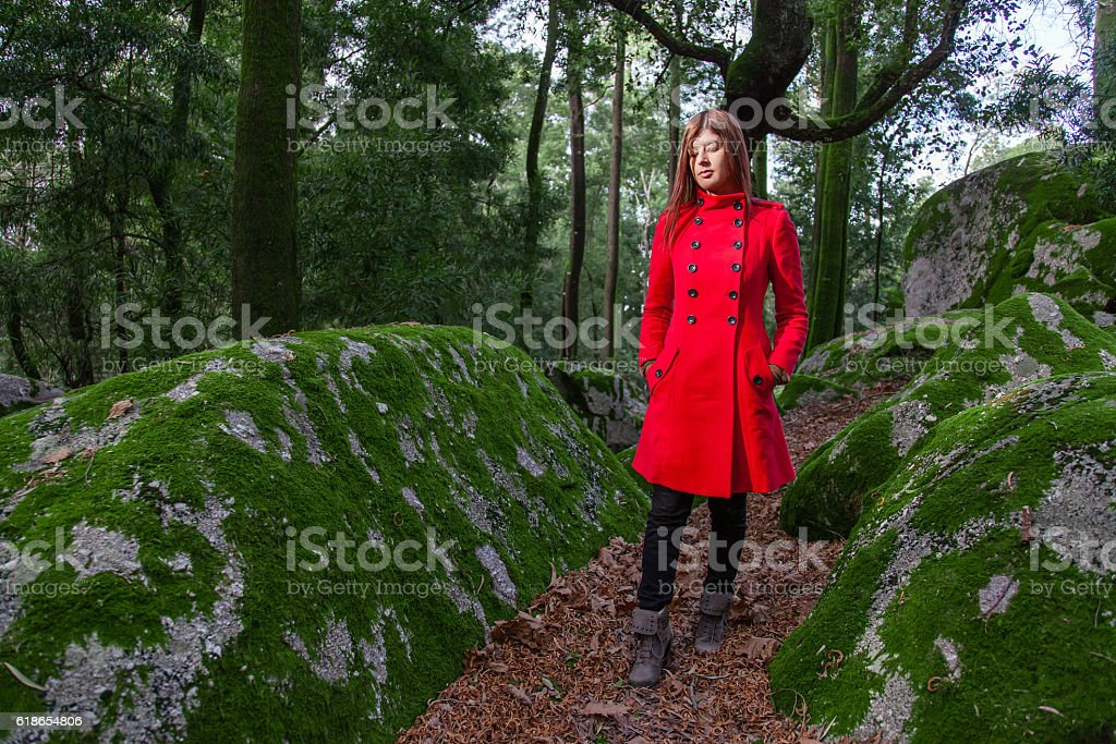 Young woman feeling sad walking on a forest stock photo