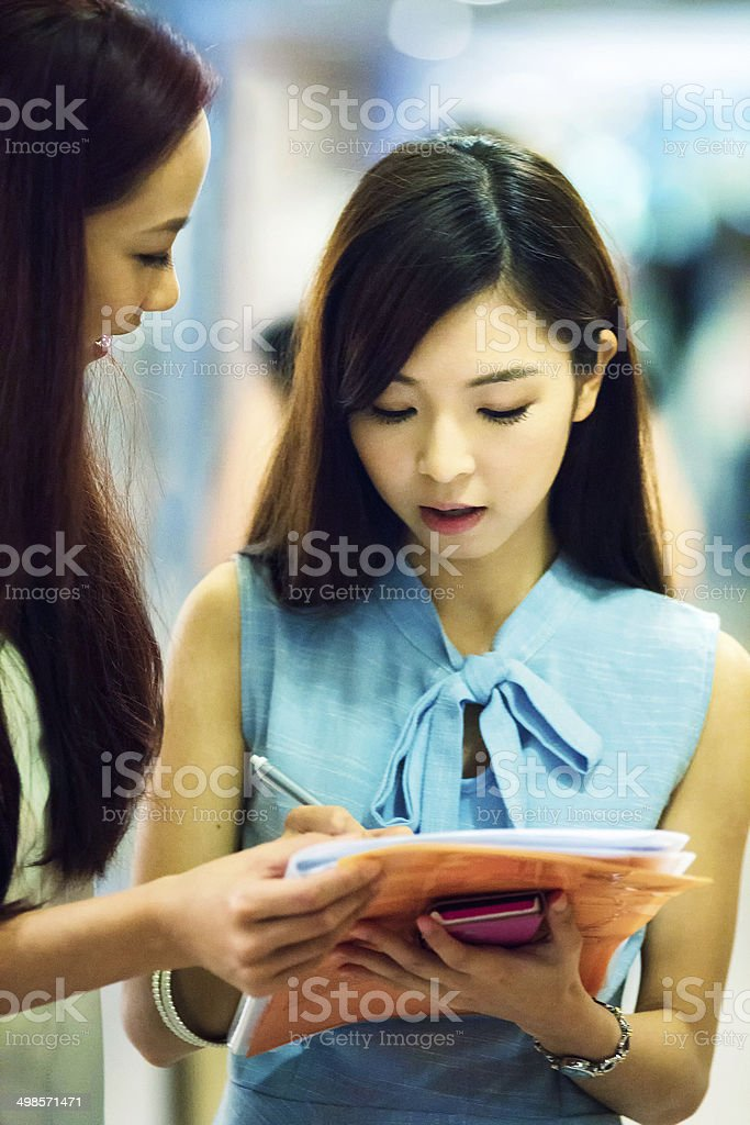 Young woman filling up survey stock photo
