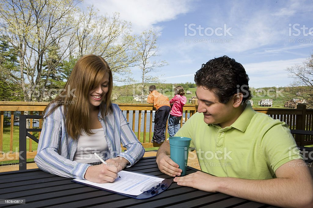 Young Woman Fills Out Paperwork royalty-free stock photo