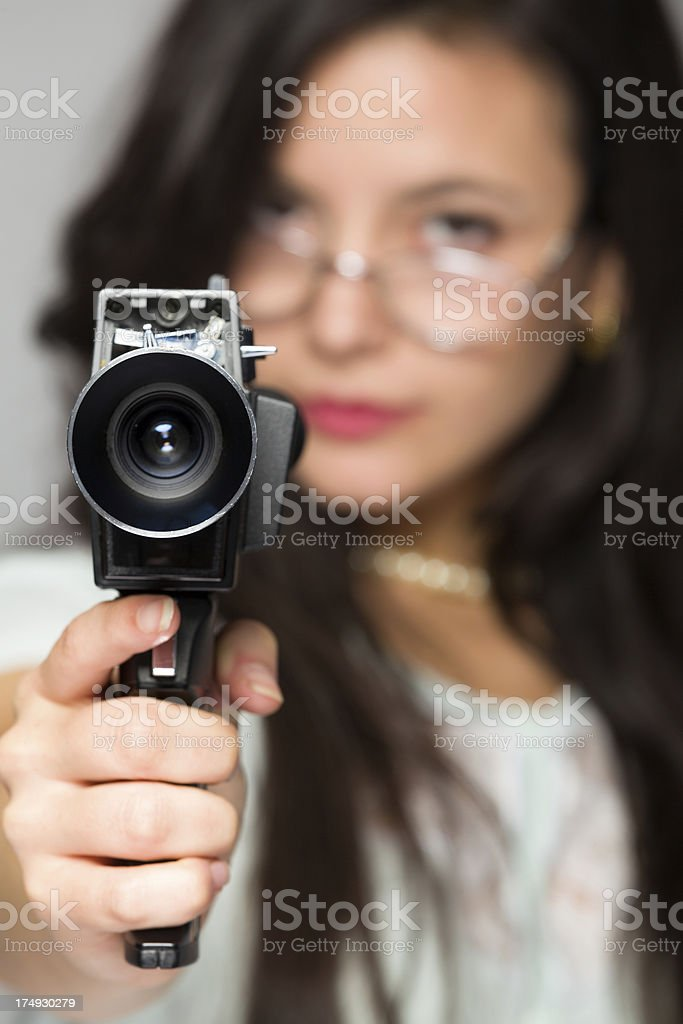 Young woman filming stock photo