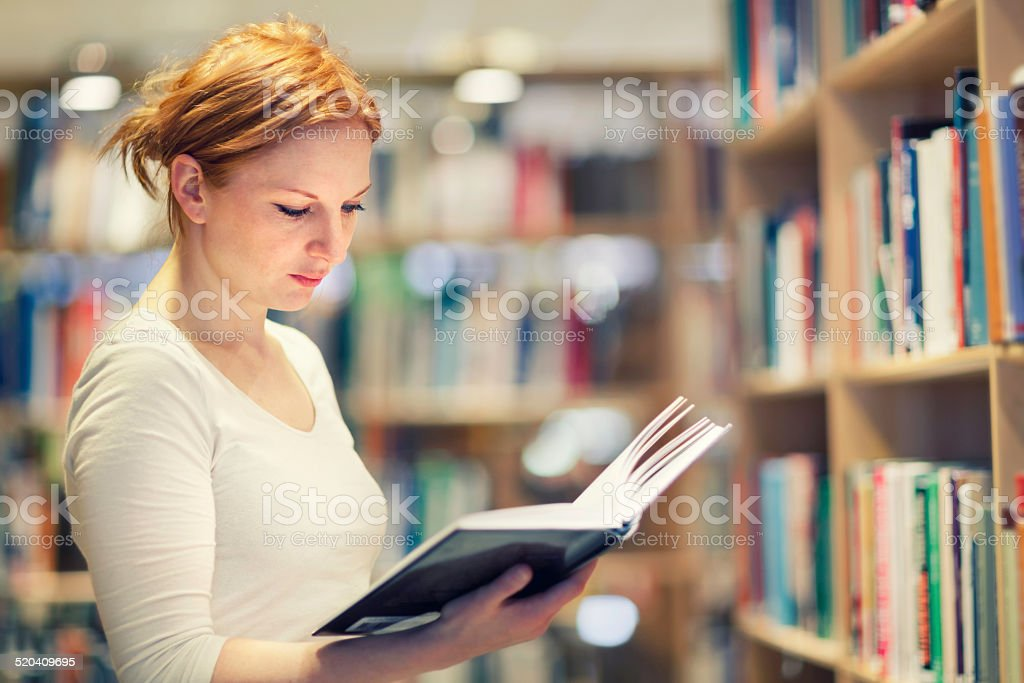 Young woman finding a good book stock photo
