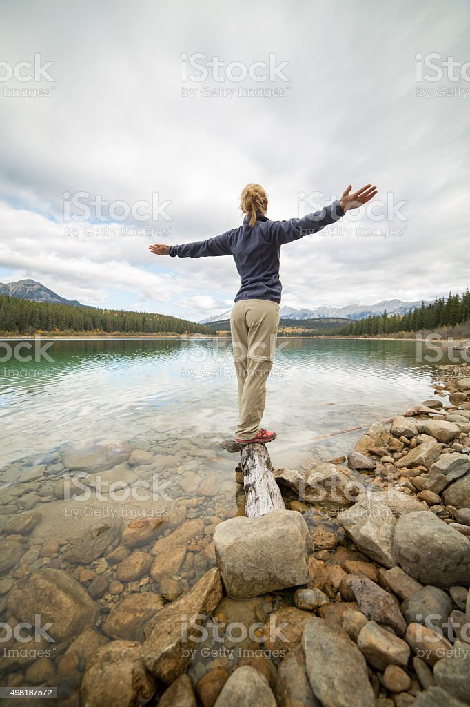 Young woman finding freedom in nature stock photo