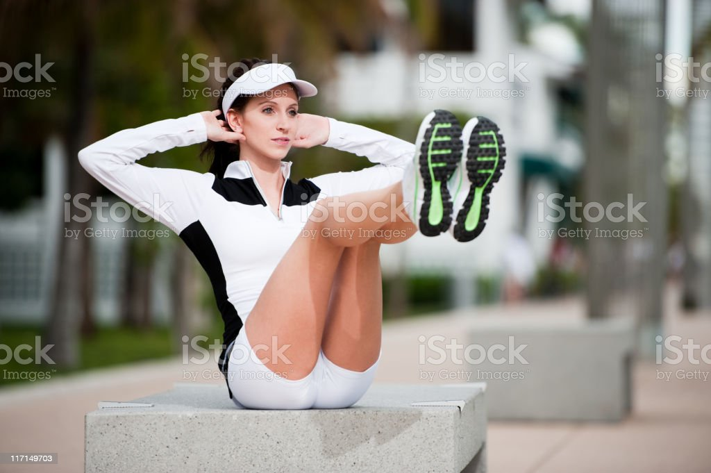 Young Woman Fitness Model Doing Abdominal Crunches royalty-free stock photo