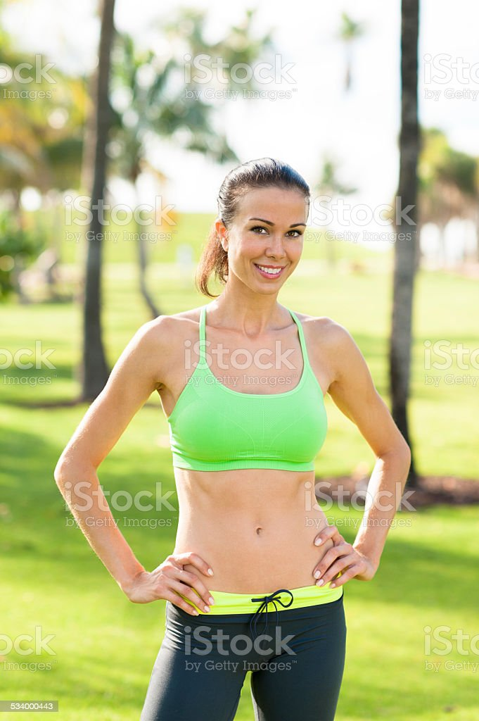 Young Woman Fitness Trainer in Tropical Park stock photo