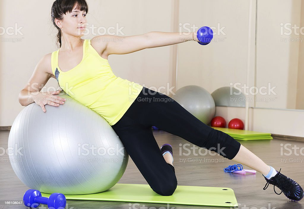 Young woman fitness workout in gym with fitball royalty-free stock photo