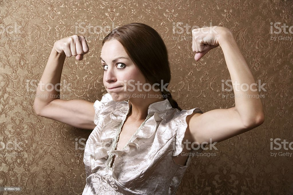 Young Woman Flexing Her Biceps royalty-free stock photo