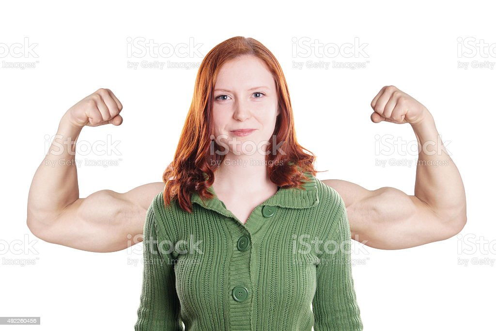 young woman flexing muscles stock photo