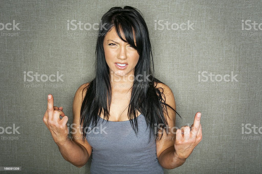 Young Woman Flipping the Bird stock photo