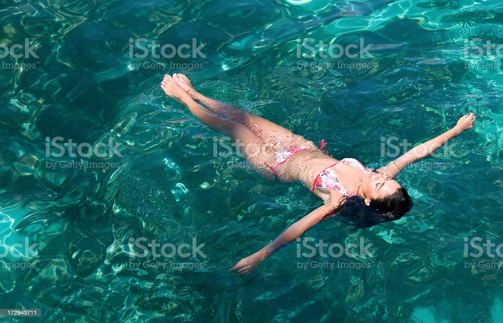 Young Woman Floating on Water royalty-free stock photo