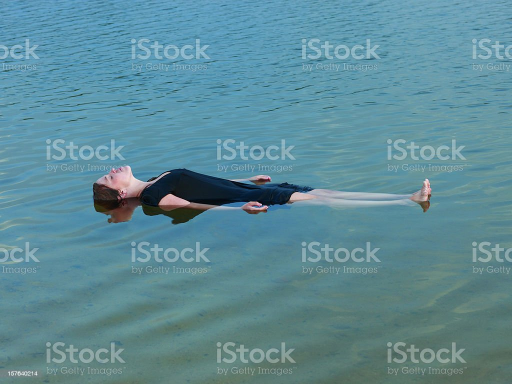 Young woman floating. stock photo