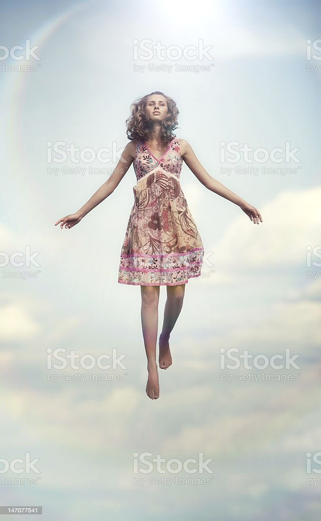 Young woman flying up stock photo