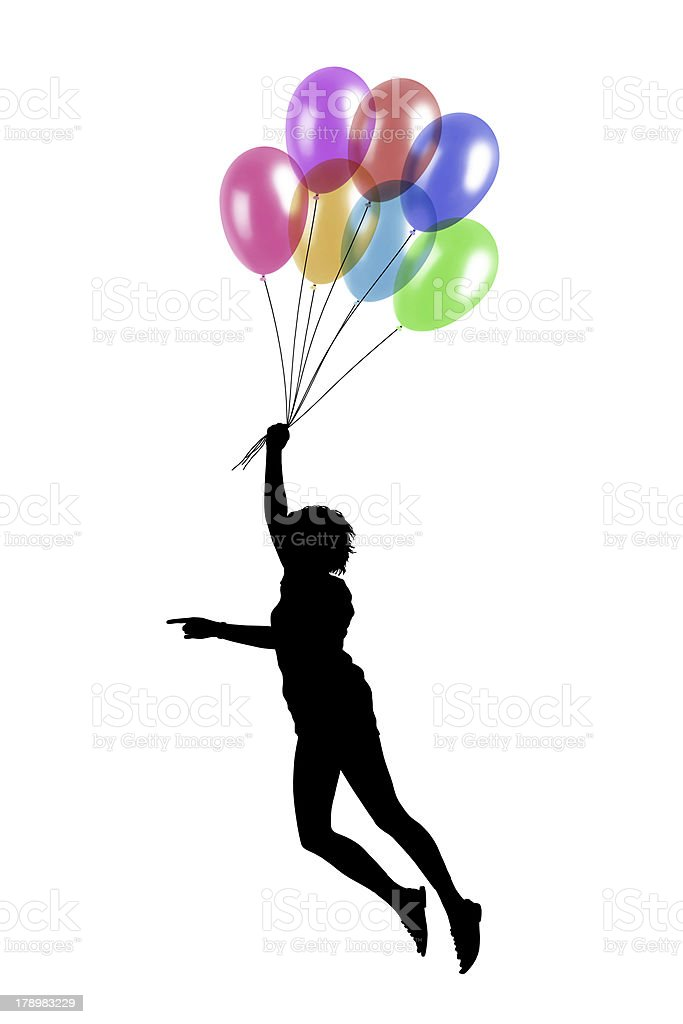 young woman flying with balloons royalty-free stock photo
